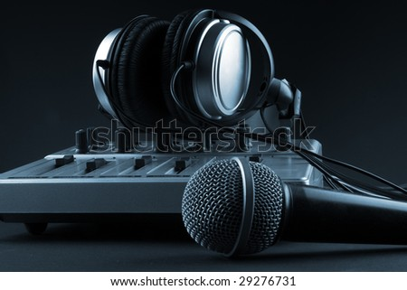 Microphone with mixer and headphones - music studio set - stock photo