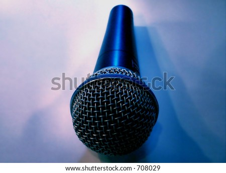 Microphone with multiple lighting sources creating several shadows - stock photo