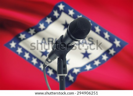 Microphone with US states flags on background series - Arkansas