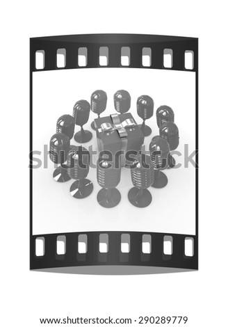 microphones around gift box. The film strip - stock photo