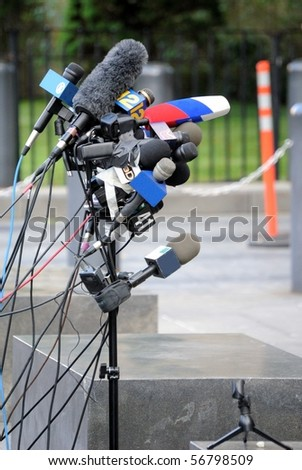 Microphones at a press conference. - stock photo