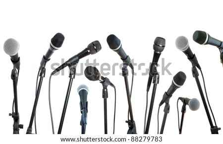 microphones collection in row isolated on white - stock photo
