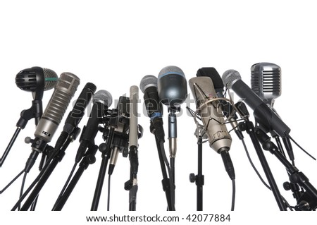 Microphones of various styles isolated over white background - stock photo