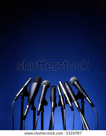microphones on blue background - stock photo