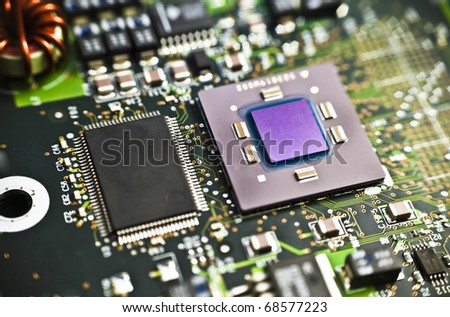 Microprocessor with clearly visible silicon core and cache chip (left of the CPU) - stock photo