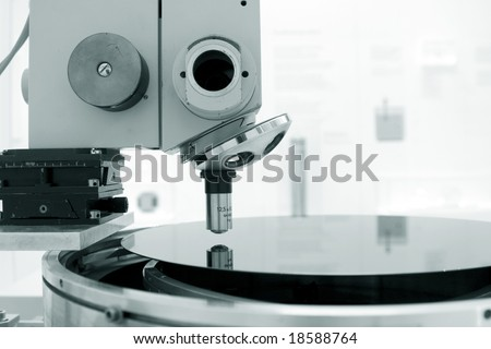 Microscope and  silicon wafer - stock photo