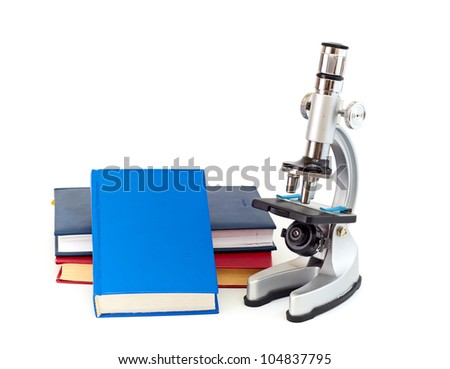 Microscope, books isolated on a white background