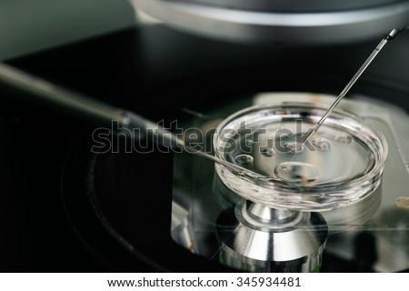 microscope for in vitro fertilization process close up. . Equipment on laboratory of Fertilization, IVF. - stock photo