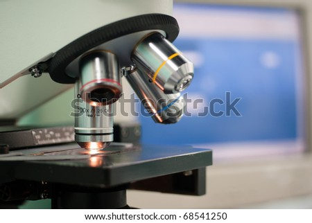 Microscope in lab - stock photo