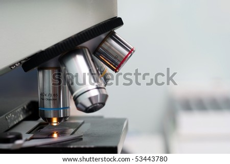 Microscope in lab on gray - stock photo