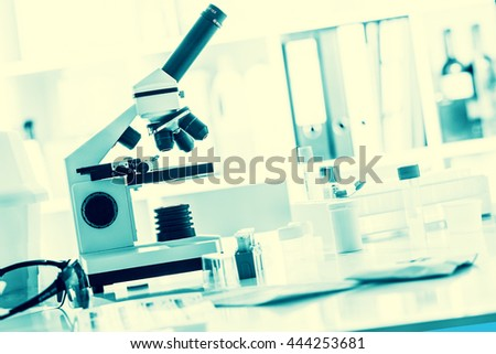 microscope in medical laboratory. Toned photo - stock photo