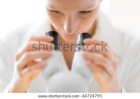 Microscope laboratory - woman medical research chemist experiment, shallow depth-of-field - stock photo