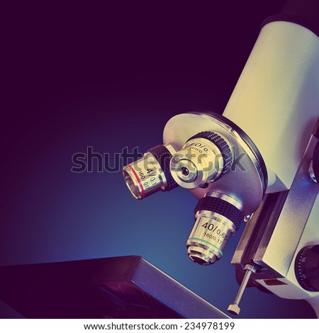 Microscope. Retro stale. - stock photo