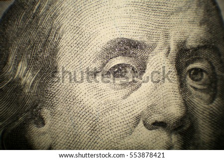 Microscopic view of Benjamin Franklin on a $100.00 dollar bill.
