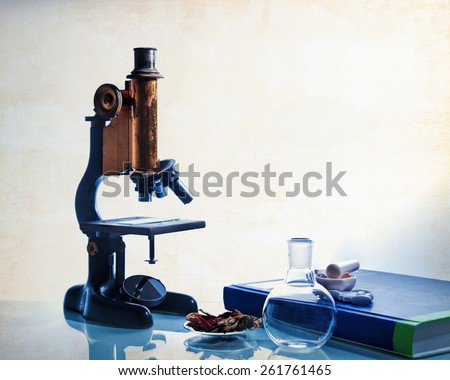 Microscopy with food, pills and text book. - stock photo