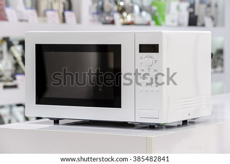 microwave oven in retail store - stock photo