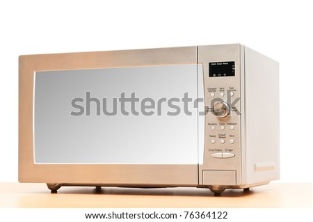 Microwave oven on the table - stock photo