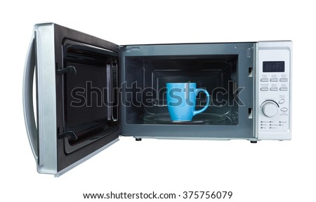 Microwave oven with a blue cup inside. Isolated on white with a clipping path. - stock photo