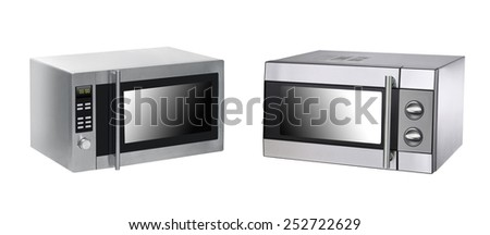 microwave ovens on background - stock photo