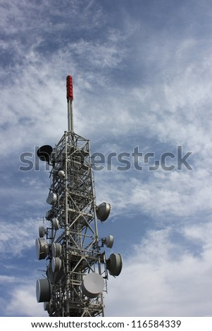 Microwave Tower with flat parabola on mountaintop of Mottarone, lago maggiore, Italy - stock photo