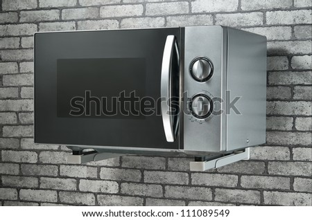microweave in kitchen on the wall - stock photo