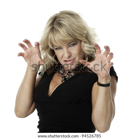 Mid-adult blond woman with angry expression and hands raised in claw-like gesture, on white background. - stock photo