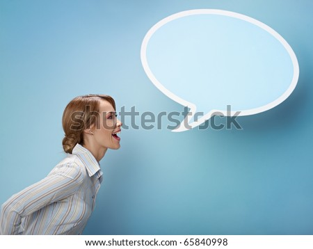 mid adult business woman screaming in blank speech bubble on blue background. Horizontal shape, side view, waist up, copy space - stock photo