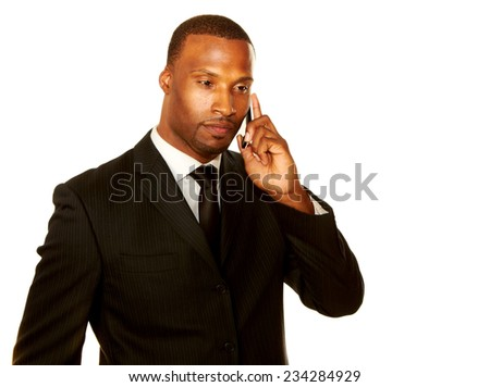 Mid adult businessman using mobile phone over white background - stock photo