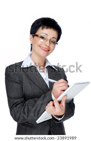 Mid adult businesswoman in grey business suit working