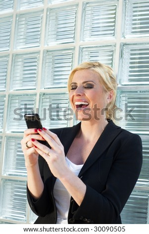 mid adult businesswoman reading phone message on smartphone. Copy space - stock photo