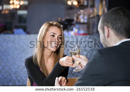 mid adult couple toasting in restaurant. Copy space