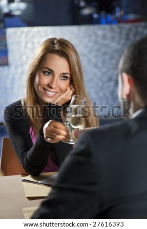 mid adult couple toasting in restaurant. Copy space - stock photo