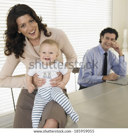 Mid adult couple with baby boy (0-6 months) - stock photo