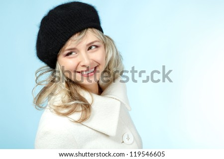 mid adult happy smiling woman winter portrait, attractive caucasian middle aged 40 years old woman in coat and hat over blue