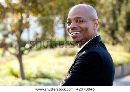 Mid adult male model in outdoor setting. Horizontally framed shot.