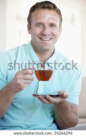 Mid Adult Man Drinking Tea - stock photo