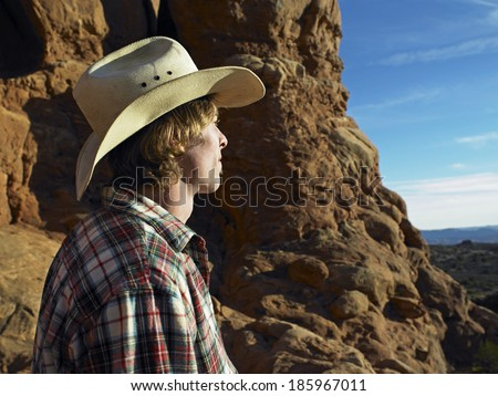 Mid Adult Man in Cowboy Hat Looking View