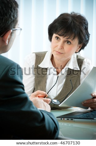 mid-adult man meeting with agent or advisor - stock photo