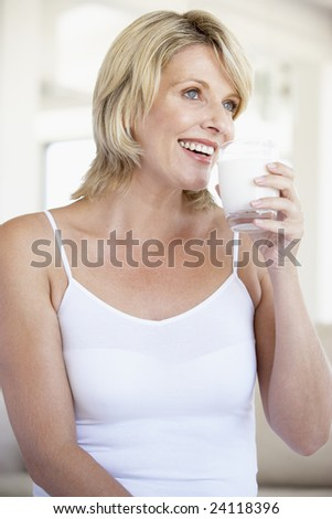 Mid Adult Woman Drinking A Glass Of Milk
