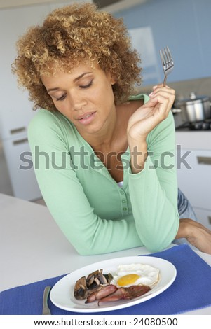 Mid Adult Woman Eating Unhealthy Breakfast