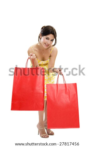 Mid adult woman holding red shopping bags on white background