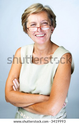 Mid adult woman laughing, portrait. - stock photo