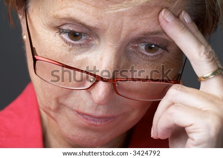 Mid adult woman suffering from depression, close-up. - stock photo