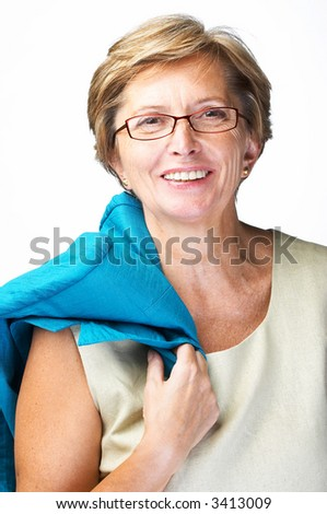 Mid adult woman wearing glasses and holding jacket smiles into camera, isolated on white - stock photo