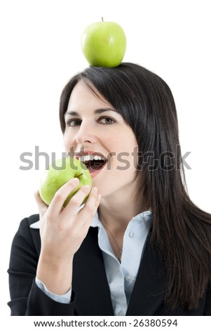 mid adult woman with green apple on head on white background - stock photo