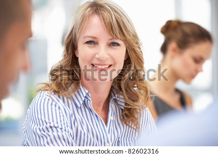 Mid age businesswoman in meeting - stock photo