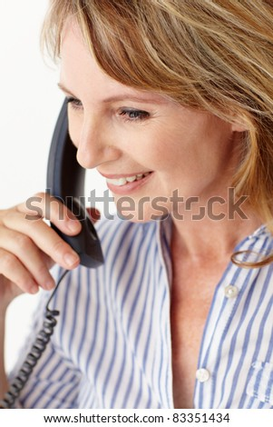 Mid age businesswoman on phone - stock photo