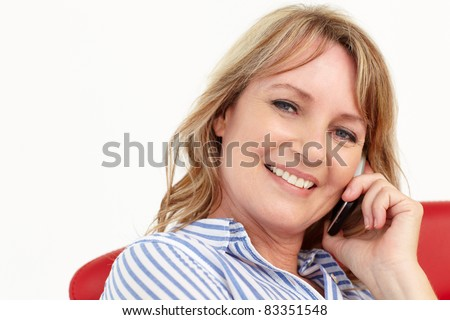 Mid age businesswoman using cellphone - stock photo
