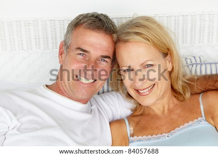 Mid age couple head and shoulders - stock photo