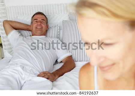 Mid age couple in bedroom - stock photo